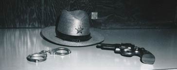 Hat, pistol, and handcuffs