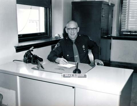 Sheriff Dean Ellis sitting at his desk