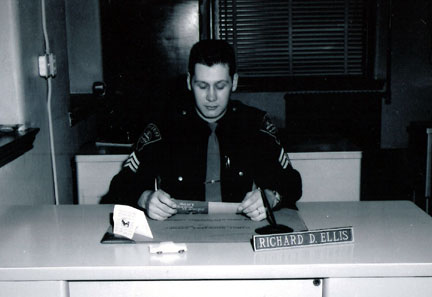 Sheriff Richard Ellis sitting at his desk