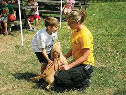 Kelly Schubert demonstrating animal care